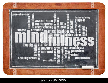 mindfulness word cloud in white chalk on a vintage slate blackboard isolated with a clipping path - Stock Photo