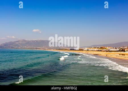 Miles of white sandy beaches of the Atlantic shore at Spanish coast of Playa De Los Lances in Tarifa, Spain. - Stock Photo