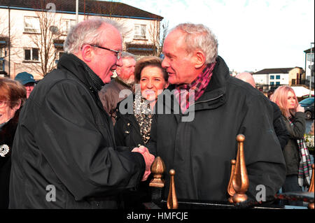 Bishop Donal McKeown speaking to Martin McGuinness, Sinn Fein, at the 45th Bloody Sunday memorial service in Derry, - Stock Photo