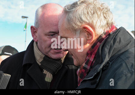 Martin Durkan MP speaking to Martin McGuinness, Sinn Fein, at the 45th Bloody Sunday memorial service in Derry, - Stock Photo