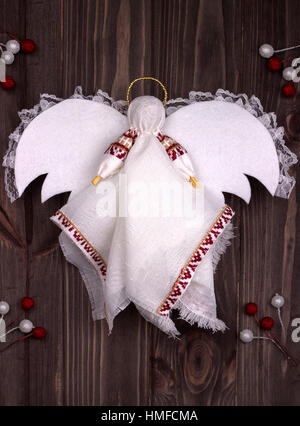 Christmas Angel textile on dark wooden background - Stock Photo
