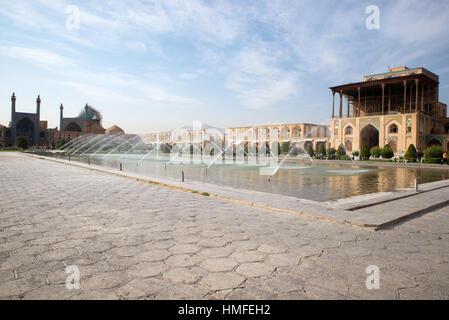 Fountains of Naqsh-e Jahan Square, Isfahan, Iran - Stock Photo