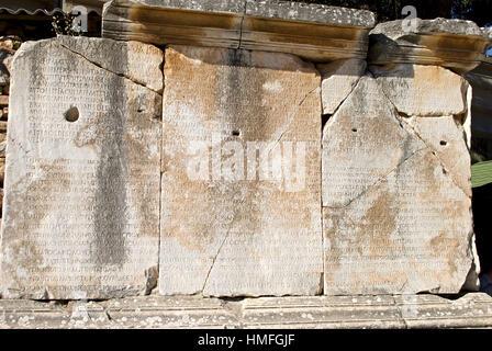 Ancient greek language inscribed on stone slabs in Ephesus, Turkey. - Stock Photo