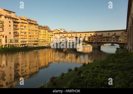 View of Ponte Vecchio, a medieval stone arch bridge on the Arno River, one of the symbols of Florence, Tuscany, - Stock Photo