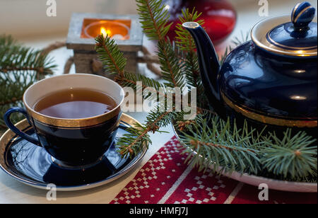 Set of decorative porcelain cup, plates, teapot with blue and gold pattern in the xmas style with tea. Food photo, - Stock Photo