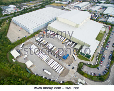 Aerial view factory HQ and commercial industry lorry semi-trucks - Stock Photo