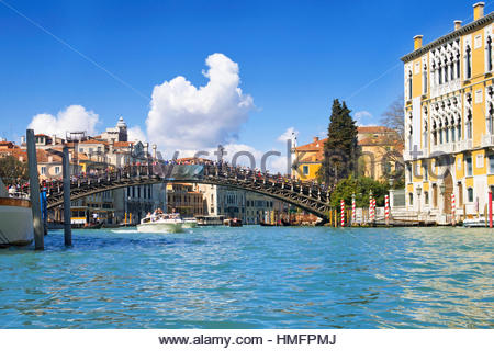 Arch Ponte dell'Accademia bridge over sunny Grand Canal with boats in Venice, Italy - Stock Photo