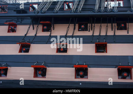 Close up of starboard Gun ports of HMS Victory - Stock Photo
