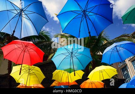 Africa, Mauritius, Port Louis, Caudan waterfront shopping area with colorful umbrellas - Stock Photo