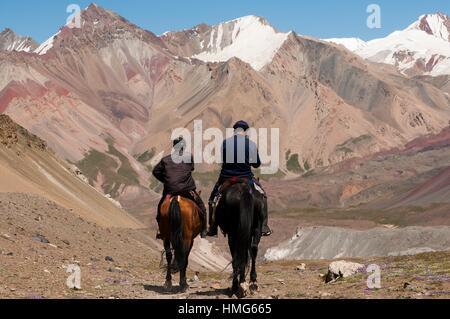 Kyrgyz  horsemen in Trans-Alay Range. Lenin peak. Pamir. Kyrgyzstan - Stock Photo