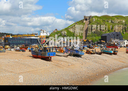 Fishing boats on Hastings Old Town Stade fishermen's beach, with the Jerwood Gallery and the East Hill Cliff Lift - Stock Photo
