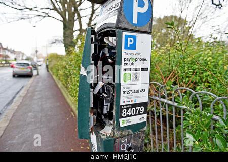 Vandalised parking ticket machine meter in Queens Park area of Brighton UK - Stock Photo