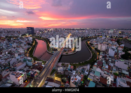 Aerial sunshine view of rooftop skyscraper on Nhieu Loc canal in Ho Chi Minh city, Vietnam - Stock Photo