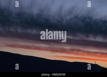 Sunset over Vitosha Mountain. TV tower of Sofia on the horizon. - Stock Photo