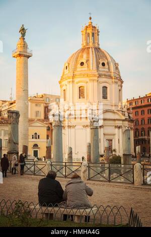 ROME, ITALY - JANUARY 07, 2014. People looking towards Trajans column - colonna traiana-  and the church of Santa - Stock Photo