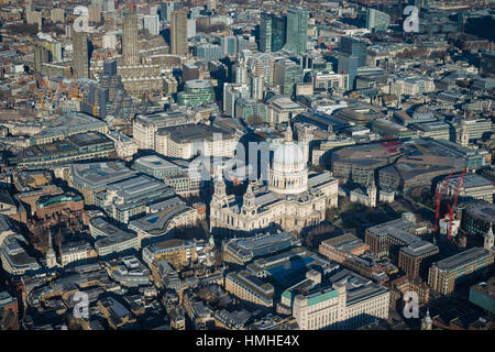 London from above, St Paul's Cathedral, surrounding area and the Barbican Estate seen from the helicopter - Stock Photo