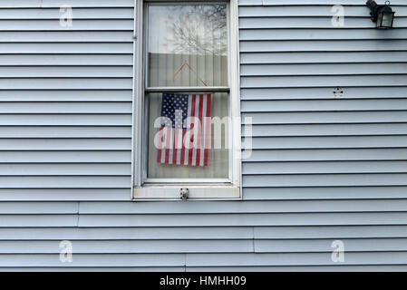 Flag in Window, Williamsburg, Brooklyn, New York City - Stock Photo