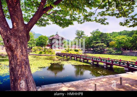 Footbridge Leading to the Pavilion of Far-Reaching Fragrance, Gyeongbokgung Palace; Seoul, South Korea - Stock Photo