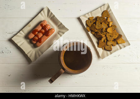 Beer Mug, Sausage, and Dried Bread on Wooden Background - Stock Photo
