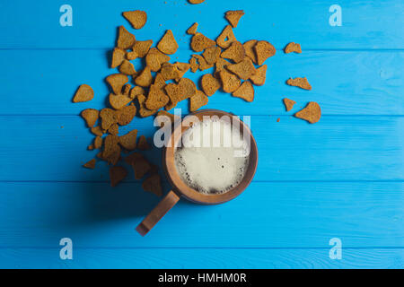 Beer Mug and Dried Bread on Wooden Background - Stock Photo