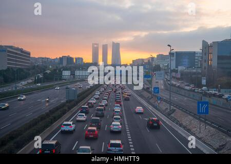 A-1 motorway and Four Towers at dusk. Madrid, Spain. - Stock Photo