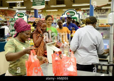 Himba woman in traditional clothing with cellphone and doing shopping at the supermaket, city of Opuwo, Kaokoland, - Stock Photo