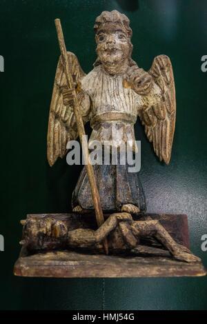 escultura de madera, San Miguel arcangel venciendo al demonio, siglo XX, museo de los iconos, castillo Real, Sanok, - Stock Photo