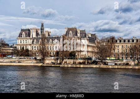 River Seine and Hotel de Ville, city hall. Paris. France - Stock Photo
