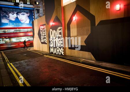 Street corner with bus in blurred motion, pedestrian and film poster of 'The Danish Girl'. Haymarket, London, England - Stock Photo