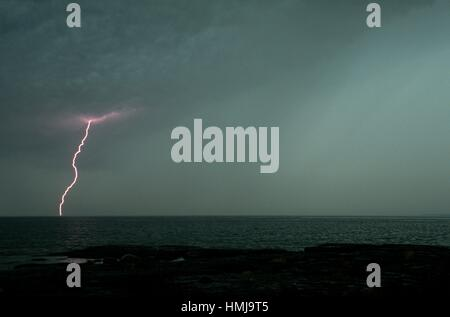 Thunderstorm and lightning strike over Mississagi Strait, Mississagi Lighthouse, Manitoulin Island, Ontario, Canada. - Stock Photo
