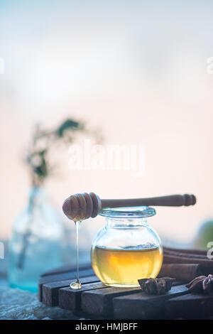 Organic honey in a glass jar - Stock Photo