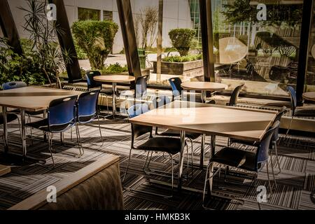 Tables and chairs in a college study area. - Stock Photo