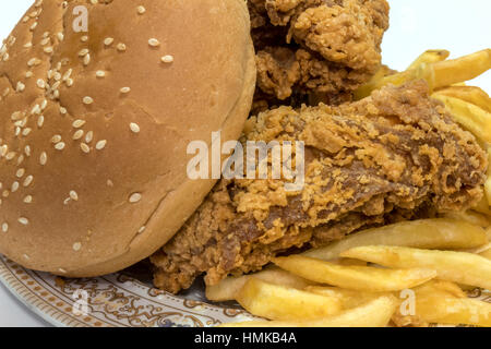 Tasty Fried potatoes with deep fried crunchy spicy chicken delicious - Stock Photo