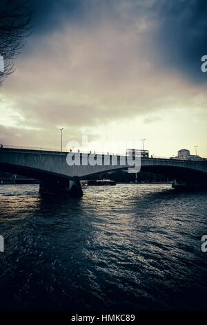 Waterloo Bridge bridge at sunset, with pedestrians and  bus. London, England - Stock Photo