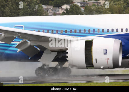 Rolls-Royce Trent 1000 engine-cowling of the first Boeing 787-8 Dreamliner prototype landing - Stock Photo