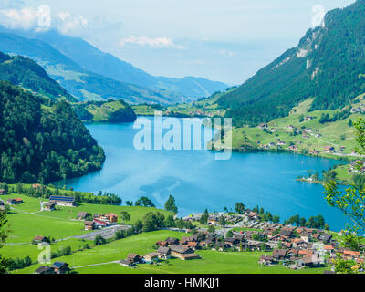 Beautiful lake Lungern and village from Brunig Pass, Switzerland. - Stock Photo