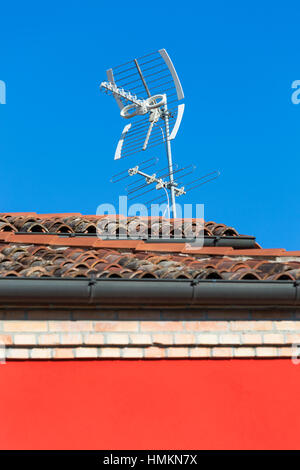 Aerials on roof of house at Burano, Venice, Italy in January - Stock Photo