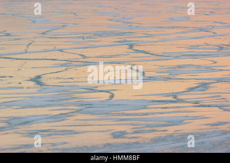 thick solid layer of ice of a frozen river - Stock Photo