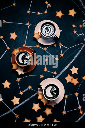 Coffee Moonrise with star-shaped cookies - Stock Photo