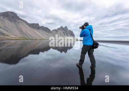 Photographer take photo near famous Stokksnes mountains, Iceland. - Stock Photo