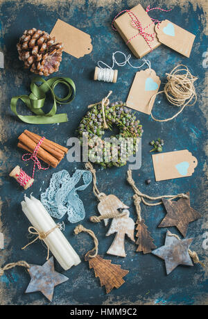 Christmas related objects on shabby table background, top view - Stock Photo
