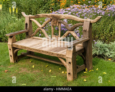 rustic garden furniture. ornate rustic wooden garden bench seat made from recycled parts in front furniture