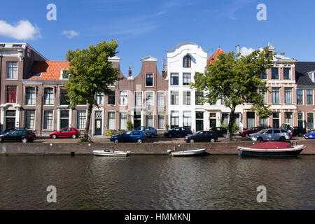 HAARLEM - AUG 8: Historical houses along a canal in old Haarlem on August 8, 2013, Haarlem, The Netherlands. At - Stock Photo