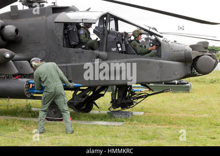 GILZE-RIJEN, NETHERLANDS - JUNE 20: AH-64 Apache attack heliopcter being armed with rockets at the Royal Netherlands - Stock Photo