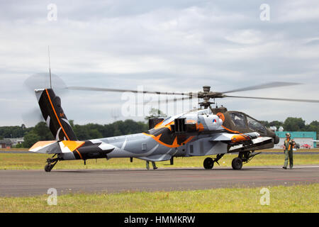 GILZE-RIJEN, NETHERLANDS - JUNE 20: Special painted Dutch Air Force AH-64 Apache about to land at the Royal Netherlands - Stock Photo
