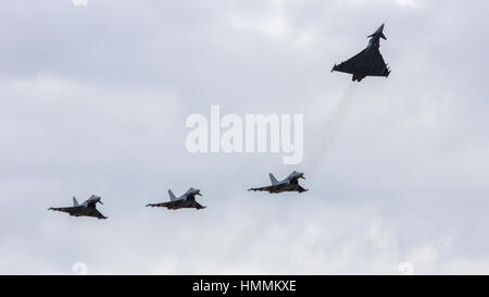 LAAGE, GERMANY - AUGUST 23: Four German Air Force Eurofighter Typhoons flyby during the German Air Force Open Day - Stock Photo