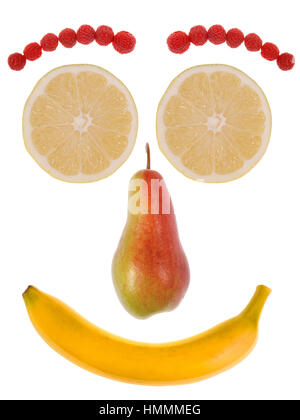 Funny face made from fruit isolated on white. - Stock Photo
