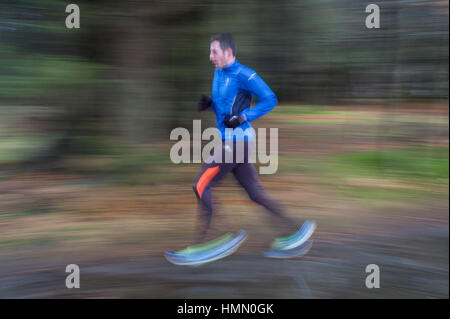 Aberdeen, UK. 4th February, 2017. Runners take part in the Aberdeen weekly Park Run on a wet Saturday morning Credit: - Stock Photo