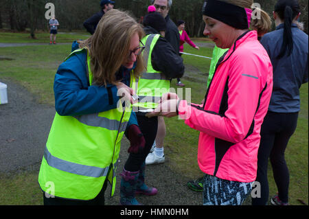 Aberdeen, UK. 4th February, 2017. Volunteer organisers and helpers at the Aberdeen weekly Park Run on a wet Saturday - Stock Photo