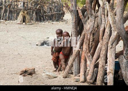 Himba children, near cattle fence, Himba village, Epupa Falls, Kaokoland, Namibia, Africa,by Monika Hrdinova/Dembinsky - Stock Photo